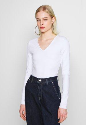 POWER SHOULDER BODYSUIT - Long sleeved top - white