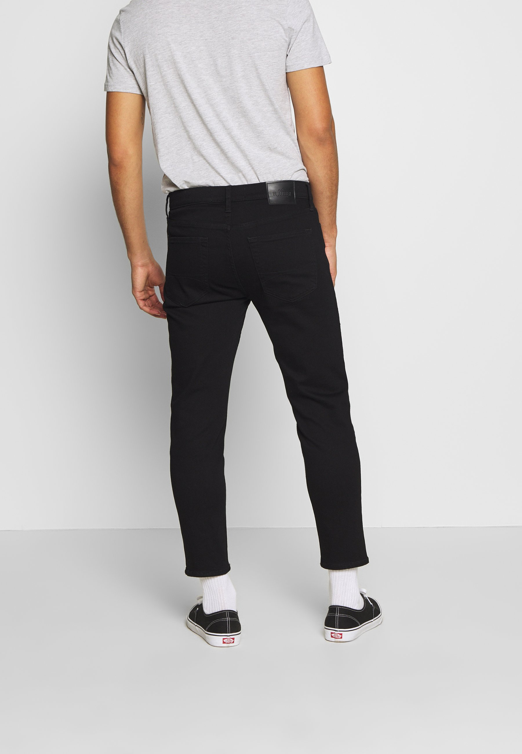 Hollister Co. TAPER CROP REPAIR - Jeans fuselé - black