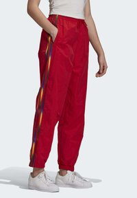 adidas Originals - PAOLINA RUSSO ADICOLOR SPORTS INSPIRED MID RISE PANTS - Tracksuit bottoms - scarlet - 2