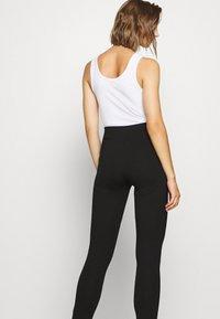 NA-KD - FRONT SLIT PANTS - Trousers - black - 4