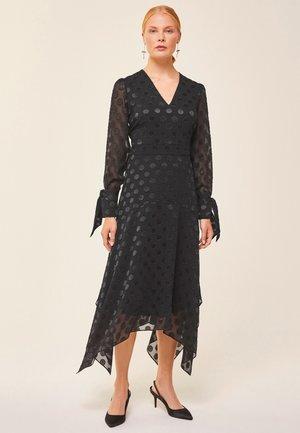 MIT PUNKTEN - Maxi dress - black
