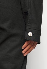 Missguided Petite - COATED CINCHED WAIST BOILERSUIT - Jumpsuit - black - 5