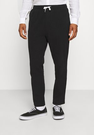 THRILLER STRUCTURED TROUSERS - Tracksuit bottoms - black