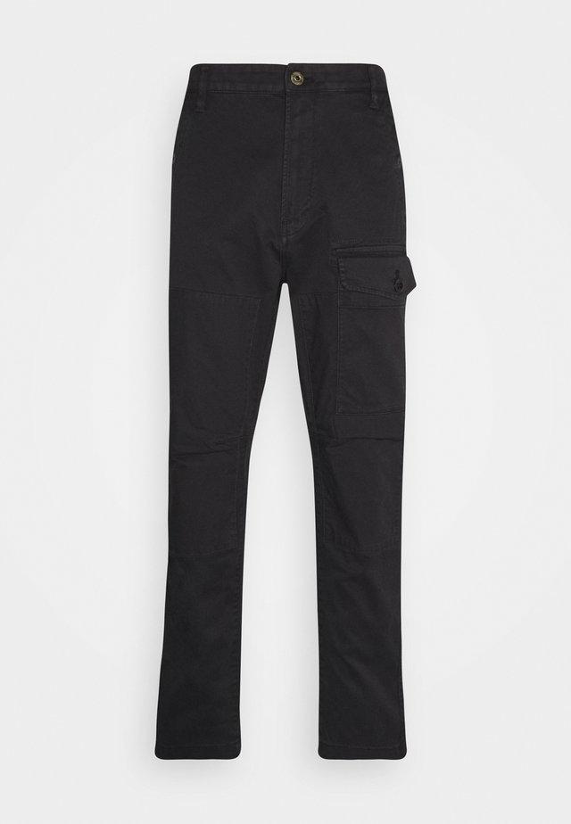TORRICK - Trousers - black