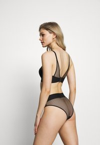 DKNY Intimates - TECH BRA - Underwired bra - black - 2