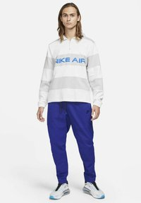 Nike Sportswear - Tracksuit bottoms - deep royal blue/black - 1