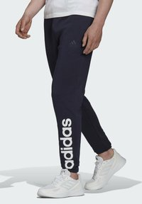 adidas Performance - LINEAR FLEECE PT SPORTS ESSENTIALS PANTS - Tracksuit bottoms - blue - 2