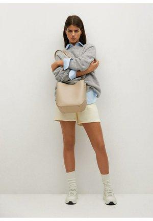 AMBERES - Handbag - ecru