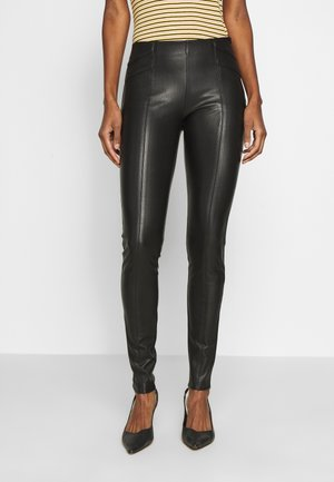 ONLTIA SUPERSTAR - Leggingsit - black