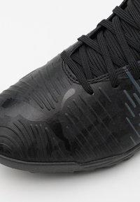 Puma - FUTURE Z 4.1 TT - Astro turf trainers - black/asphalt - 5