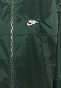 Nike Sportswear - REVIVAL - Kevyt takki - galactic jade/sail - 6
