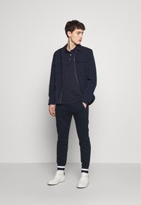 Michael Kors - Polo shirt - dark midnight - 1