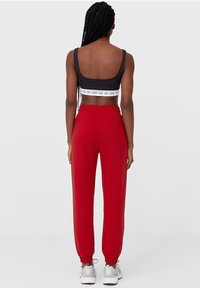 Stradivarius - Tracksuit bottoms - red - 2