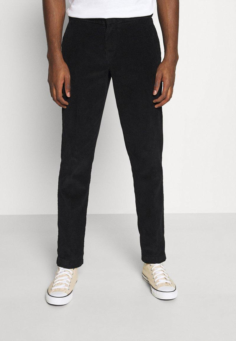 Dickies - FORT POLK - Trousers - black