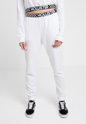 HIGH RISE JOGGER WITH LOGO ELASTIC BAND - Tracksuit bottoms - white