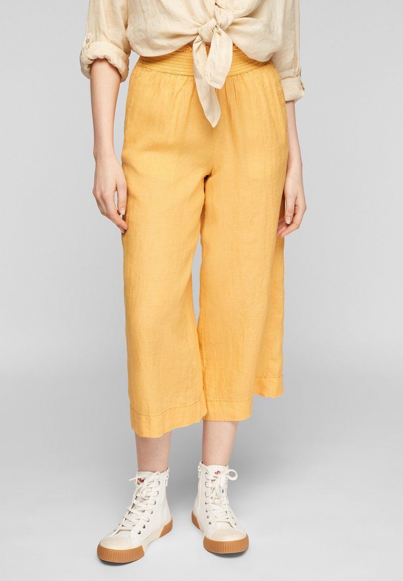 s.Oliver - Trousers - sunset yellow melange