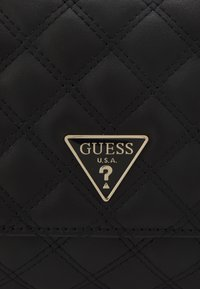 Guess - CESSILY CONVERTIBLE XBODY FLAP - Across body bag - black - 4