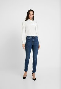 Selected Femme - SLFHALEY SLIM DELUGE - Slim fit jeans - dark blue denim - 1