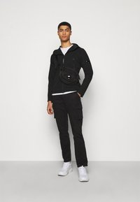 C.P. Company - OUTERWEAR MEDIUM JACKET - Lehká bunda - black - 1