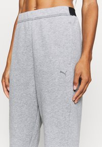 Puma - TRAIN FAVORITE JOGGER - Tracksuit bottoms - medium gray heather - 6