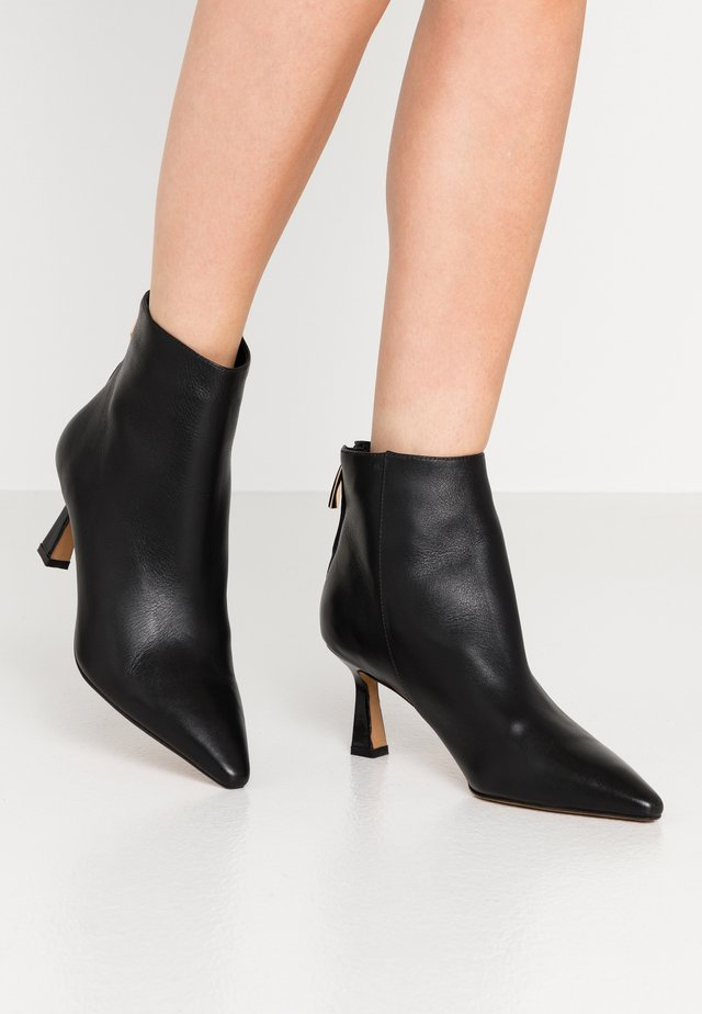 CARIS ZIP - Ankle boots - black