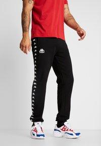 Kappa - VENTUN PANTS - Spodnie treningowe - black - 0