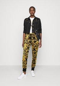 Versace Jeans Couture - Tracksuit bottoms - black - 1