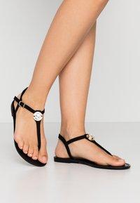 PARFOIS - T-bar sandals - black - 0