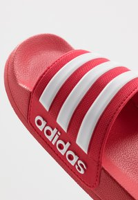 adidas Performance - ADILETTE SHOWER - Pool slides - scarle/footwear white - 2