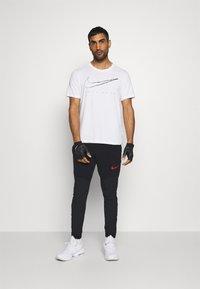 Nike Performance - FLEX PANT  - Tracksuit bottoms - black - 1