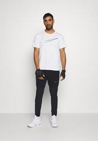 Nike Performance - FLEX PANT  - Træningsbukser - black - 1