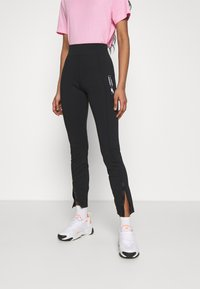 Nike Sportswear - LEGASEE ZIP - Leggings - black/white - 0