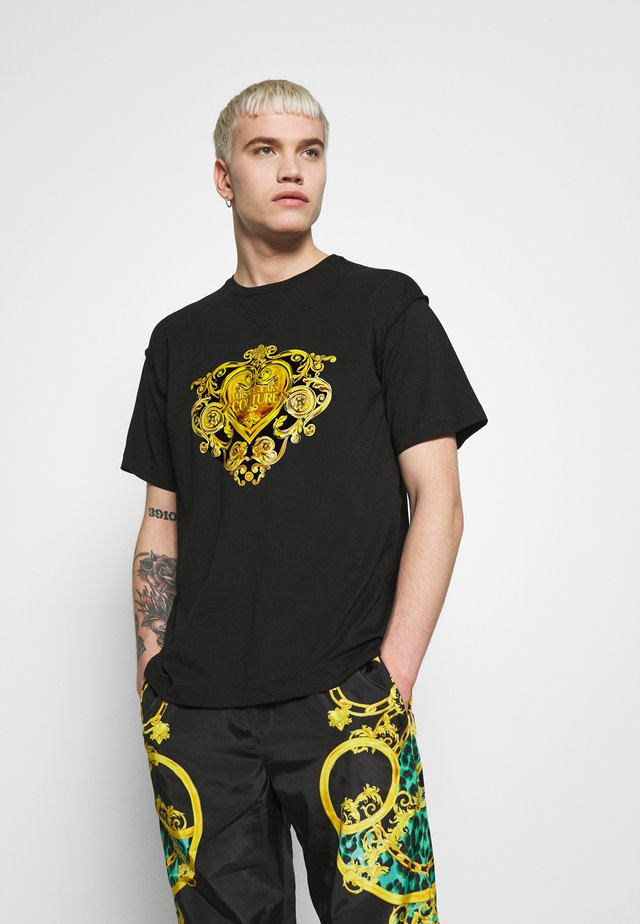 T-shirt con stampa - black/gold