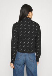 Calvin Klein Jeans - LOGO HALF ZIP - Felpa - black - 2