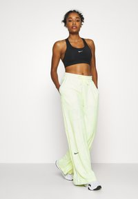 Nike Performance - CITY TRAIN PANT - Tracksuit bottoms - barely volt/spruce aura/reflect black - 1