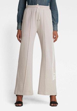 STRIPE RAW FLARED SWEAT PANTS - Broek - light lox