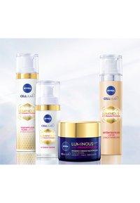 Nivea - CELLULAR LUMINOUS TINTED DAY CARE - Face cream - - - 3