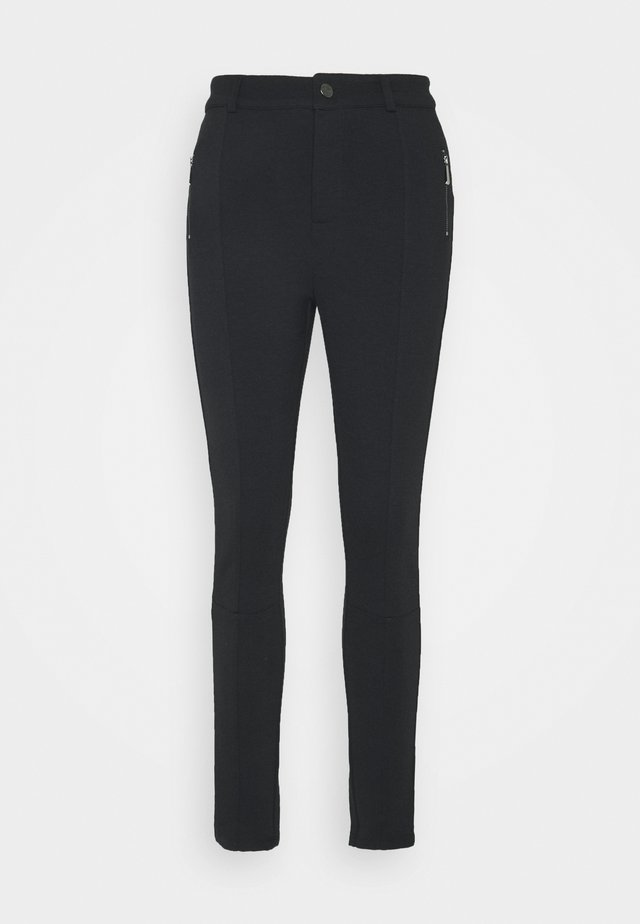ZIP DETAIL PANTS - Legginsy - black