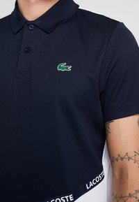 Lacoste Sport - TENNIS - Sports shirt - navy blue/white/ red - 6