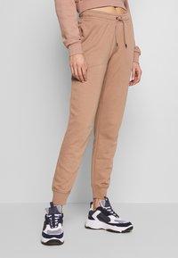 Nike Sportswear - Tracksuit bottoms - desert dust - 0