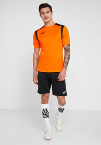 Joma - CHAMPION - T-shirt print - orange/black - 1