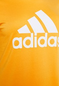 adidas Performance - Print T-shirt - mustard yellow