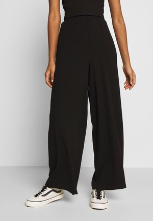 BELL TROUSERS - Bukse - black