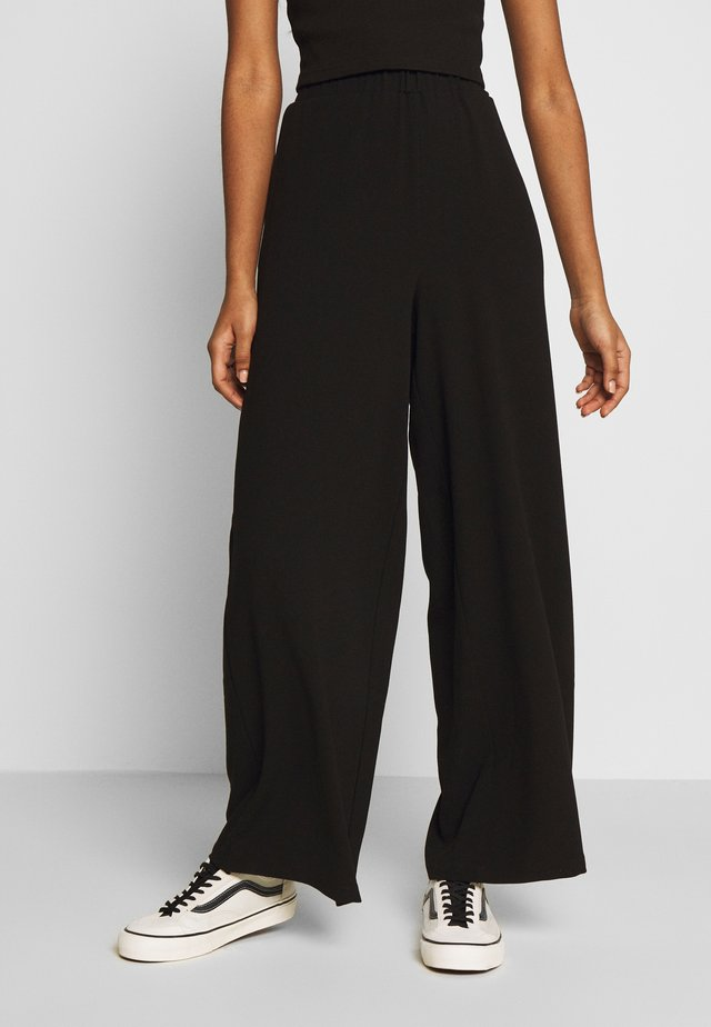 BELL TROUSERS - Stoffhose - black