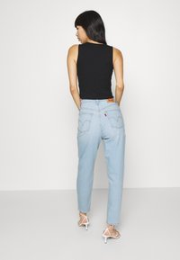 Levi's® - HIGH WAISTED - Jeansy Zwężane - light-blue denim