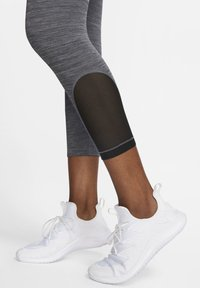 Nike Performance - CROP - Legginsy - black, dark grey