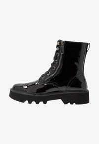 Calvin Klein Jeans - DIAHNE - Platform ankle boots - black - 1