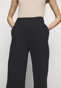 Filippa K - JANNIE TROUSER - Kalhoty - black - 3