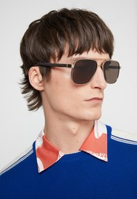 Gucci - Sonnenbrille - gold/brown - 1
