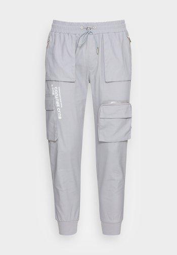 BELLOWED POCKET SIGNATURE  - Reisitaskuhousut - mint